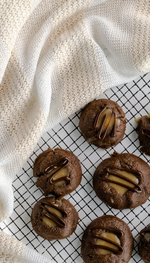 Chocolate thumbprint filled with peanut butter and drizzled with chocolate.