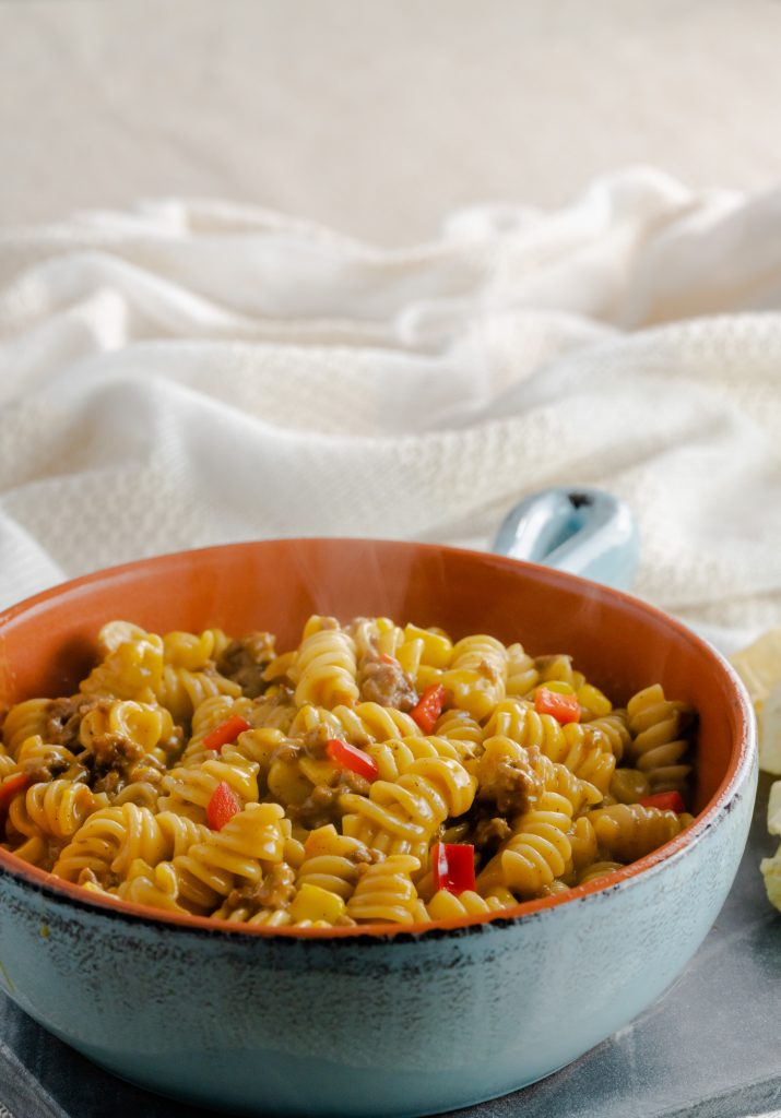 Instant Pot taco pasta made with rotini noodles, red peppers, and super sweet corn.