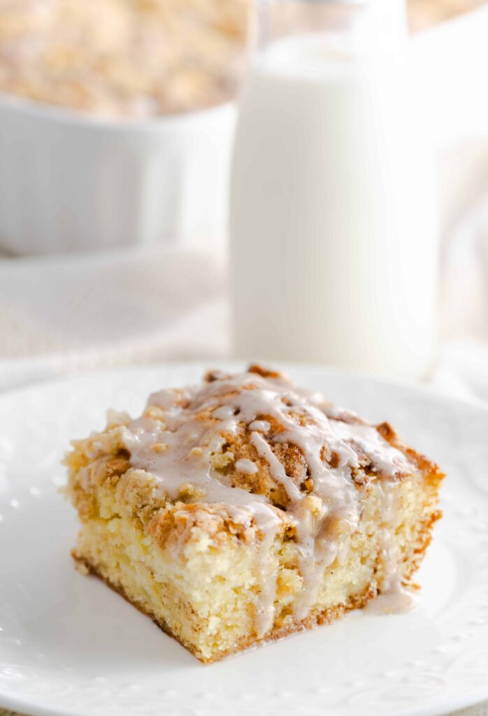 Moist and flavorful apple crumb coffee cake topped with an apple, oatmeal, and brown sugar streusel.