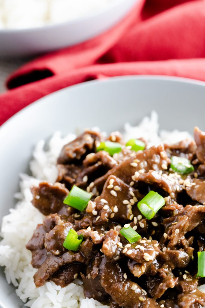 Instant Pot Garlic Sesame & Beef made with jasmine rice. in a gray bowl.