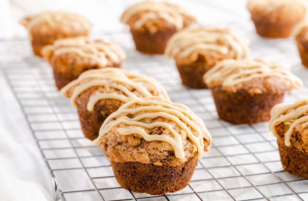 Caramel banana muffins cooling on a wire rack.