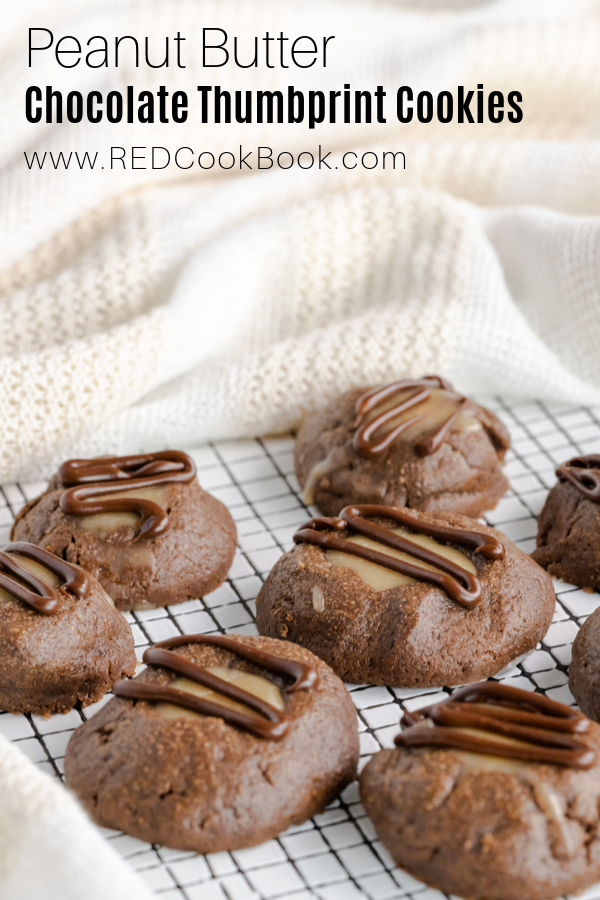 Chocolate thumbprint cookies with a creamy and smooth peanut butter filling.  These cookies are finished off with a chocolate drizzle.  #thumbprintcookies #cookies #cookieexchange #holidaycookies #christmascookies #peanutbutter #peanutbuttercookies