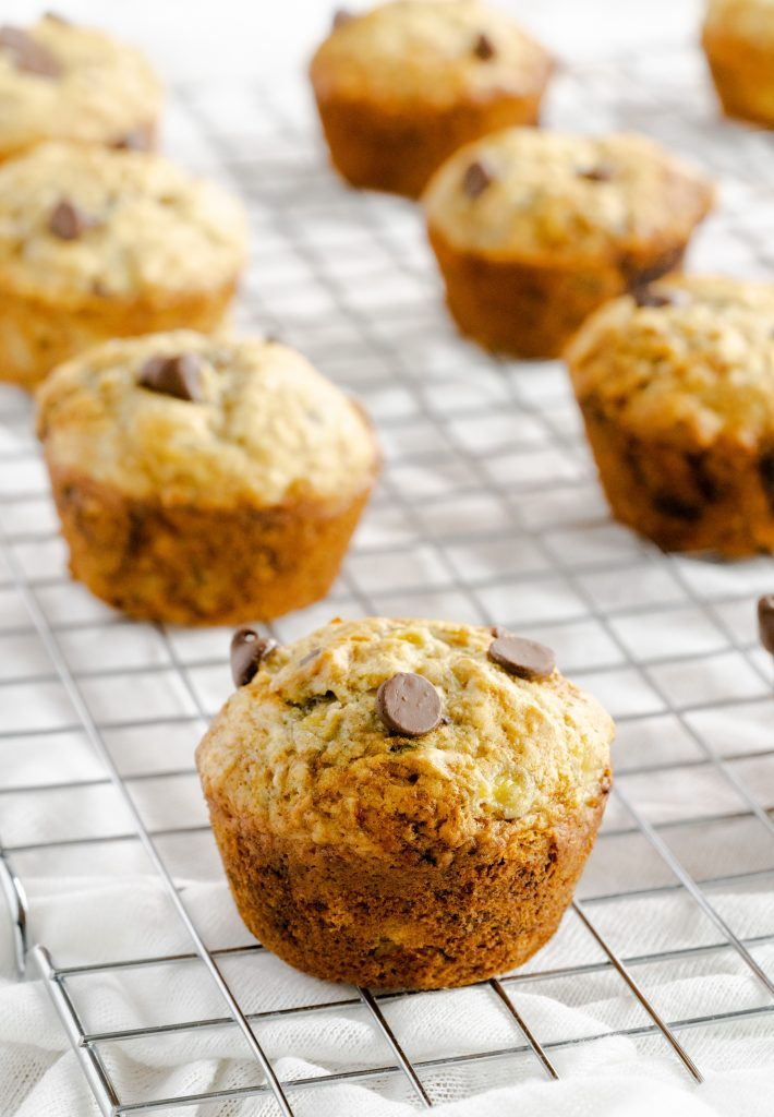 Banana Chocolate Chip Muffins cooling on a wire rack without wrappers.