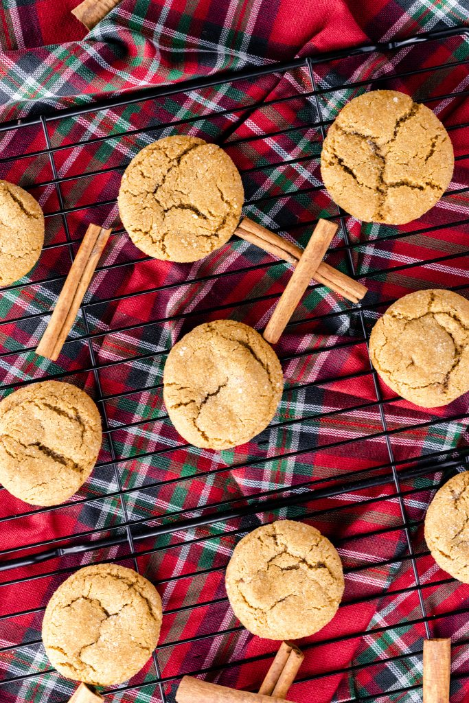soft and chewy gingersnap cookies on wire rack