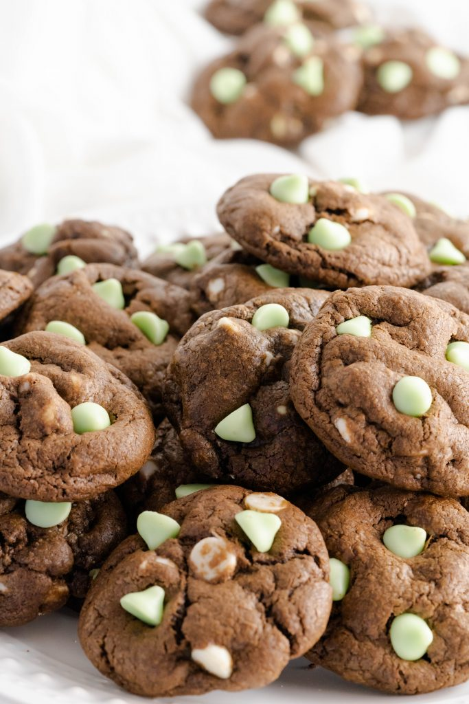 Close up of mint chocolate chip cookies mixed with white chocolate chips.