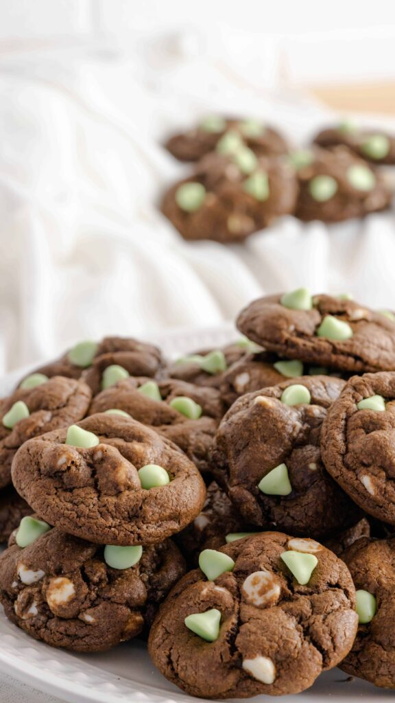 A decorative plate with mint chocolate and white chocolate chip cookies.