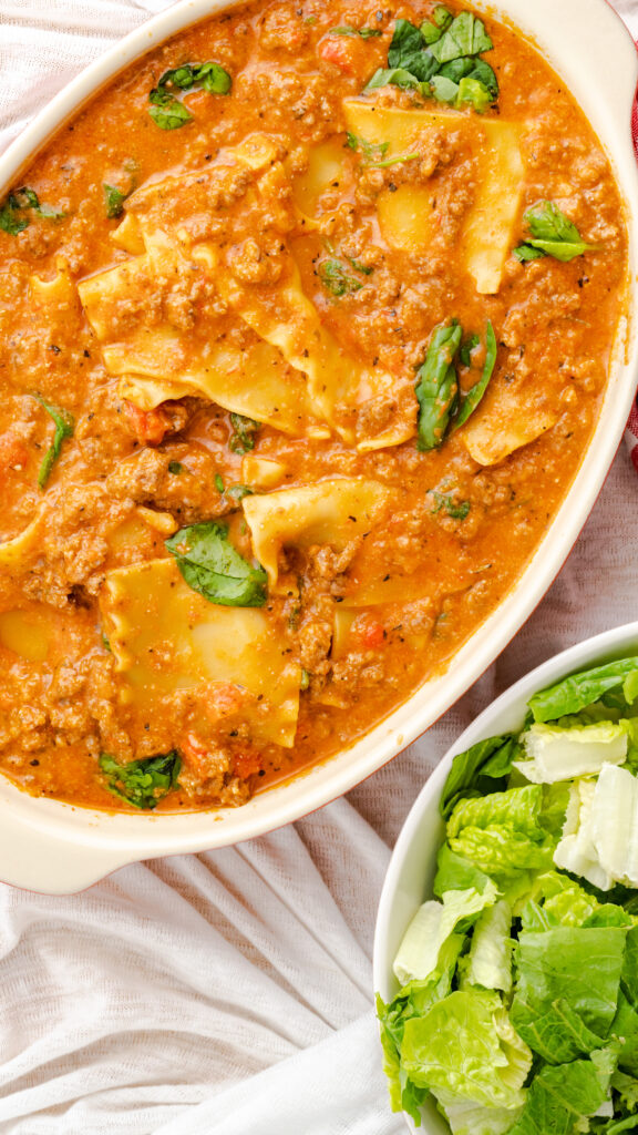Casserole dish with lazy lasagna and salad