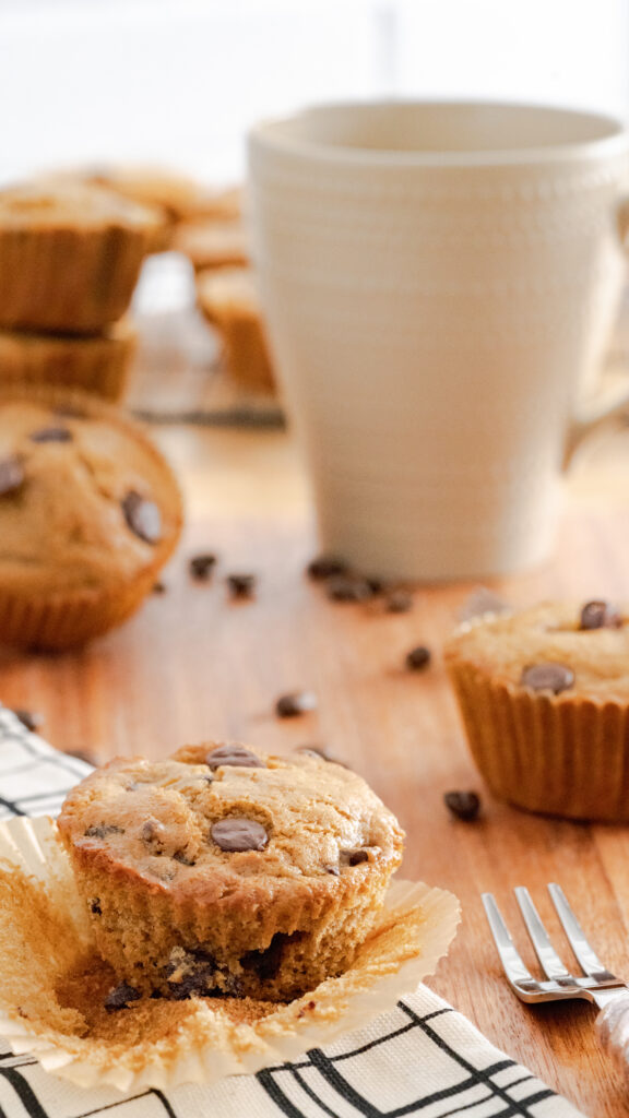 Espresso muffins with a fork and a cup of coffee.