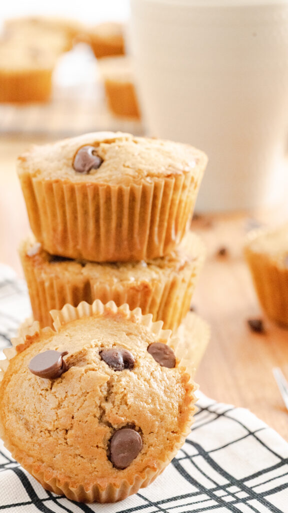 Stacked cappuccino muffins on a black and white napkin.