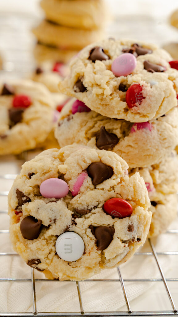 Stacked M&M cookies with Valentine's Day colors.