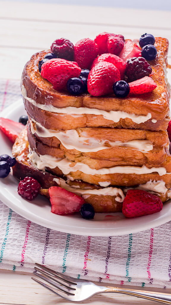 mixed berries on top of stuffed French toast